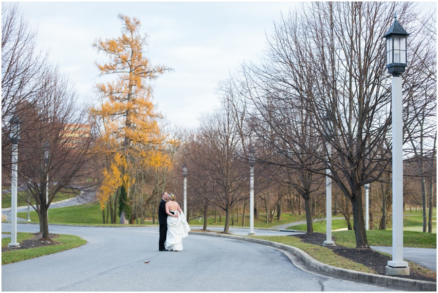 Hayfield Winter Wedding Photographer - orange tree - bride and groom in the street
