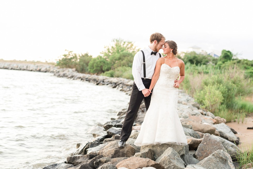 Couple on the rocks at sunset for a shore Wedding by Philadelphia wedding photographer