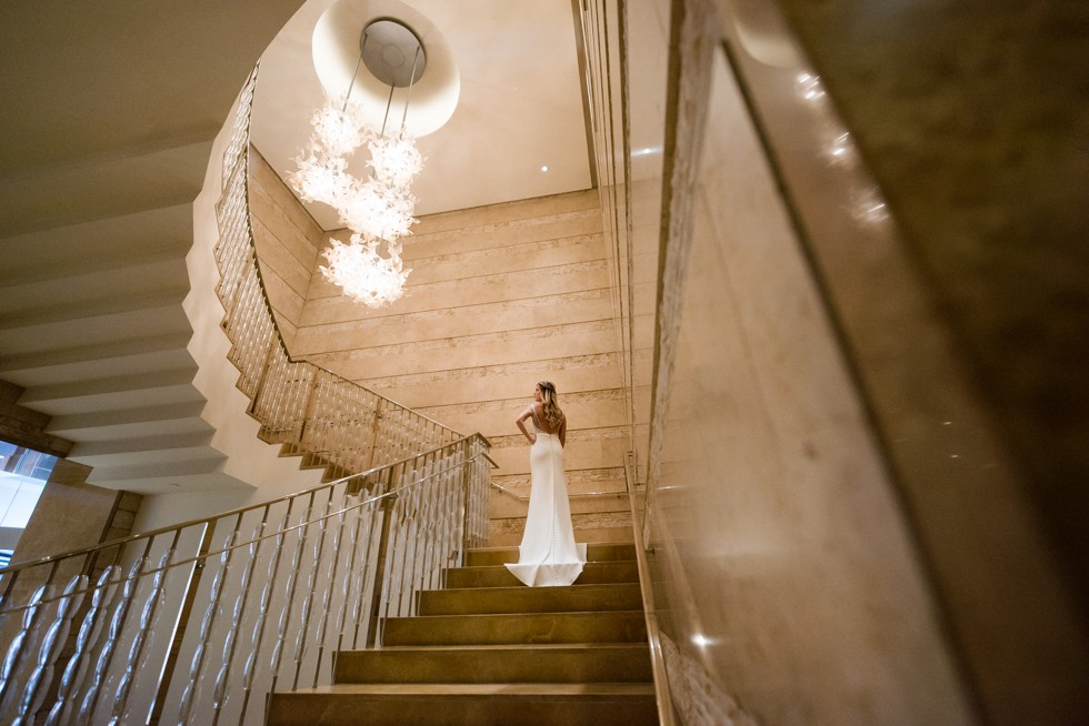 Four Seasons Hotel baltimore bride wearing a martina liana wedding dress on the grand gold staircase