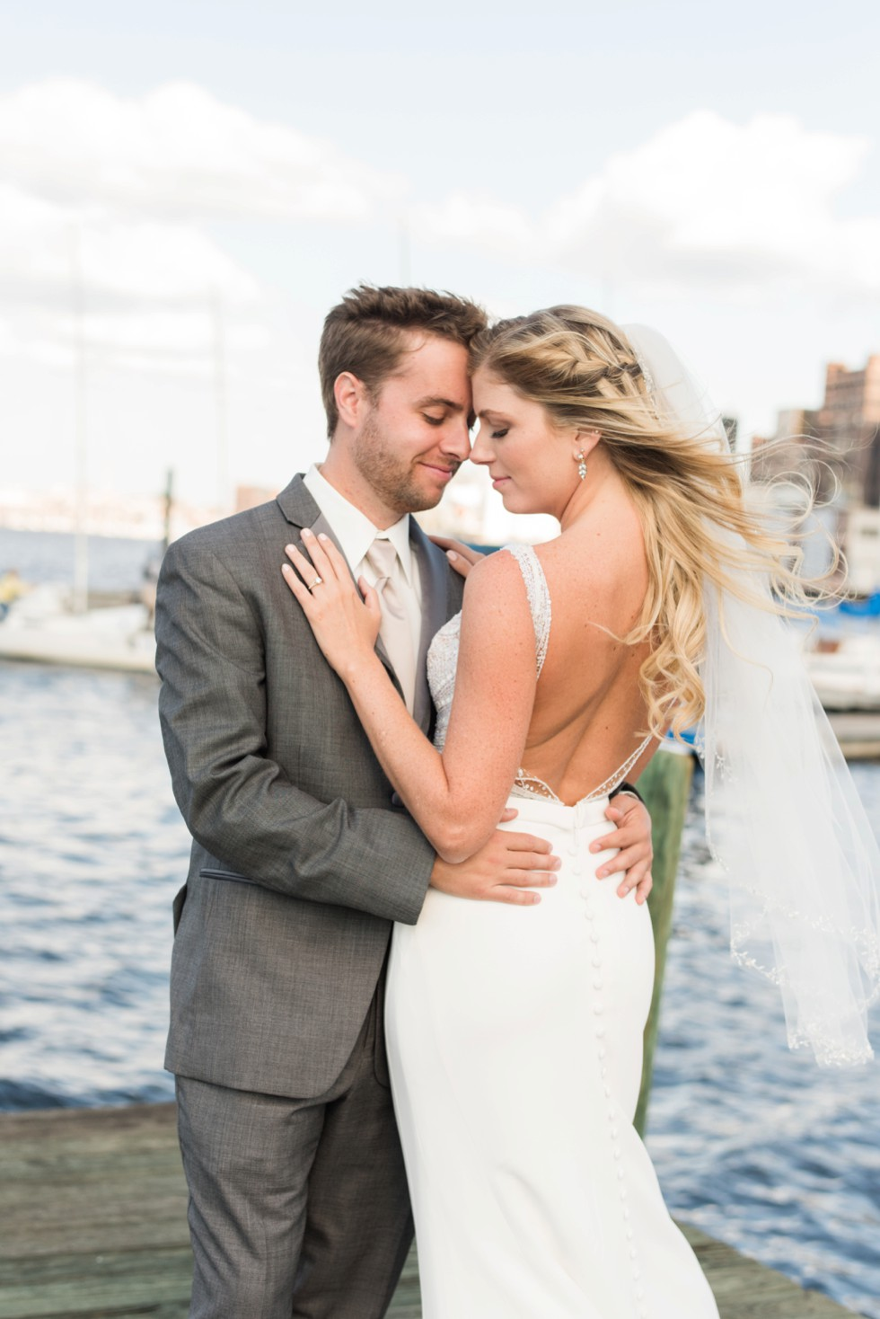 Baltimore Museum of Industry wedding photos with a sailboat on the baltimore harbor