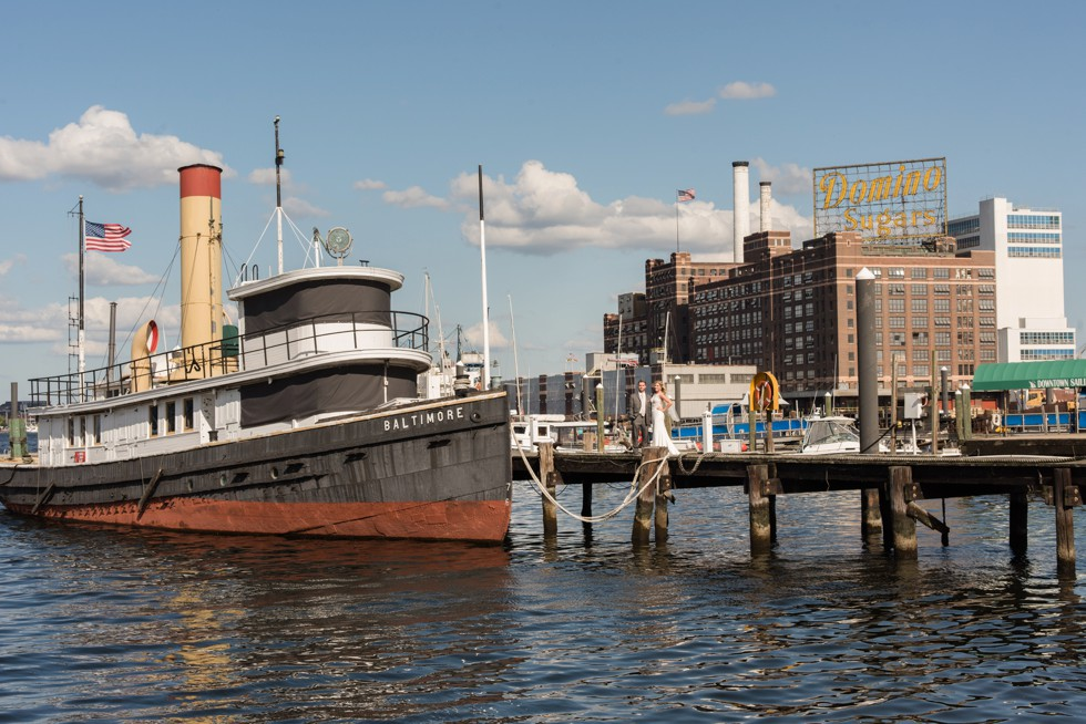 Baltimore Museum of Industry wedding photos with a tugboat on the baltimore harbor