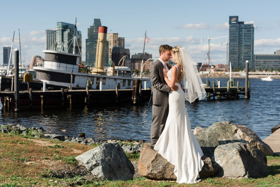 Bride and Groom standing on rocks at the Baltimore Museum of Industry