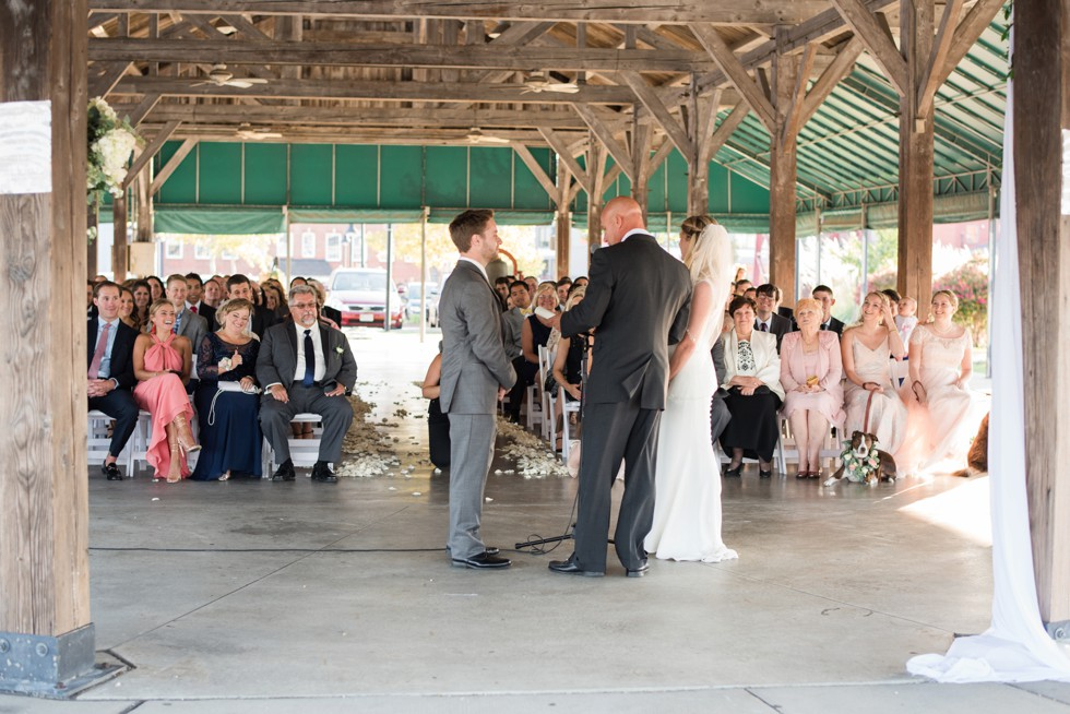 Wedding ceremony overlooking the Baltimore Harbor under the wooden barn at BMI