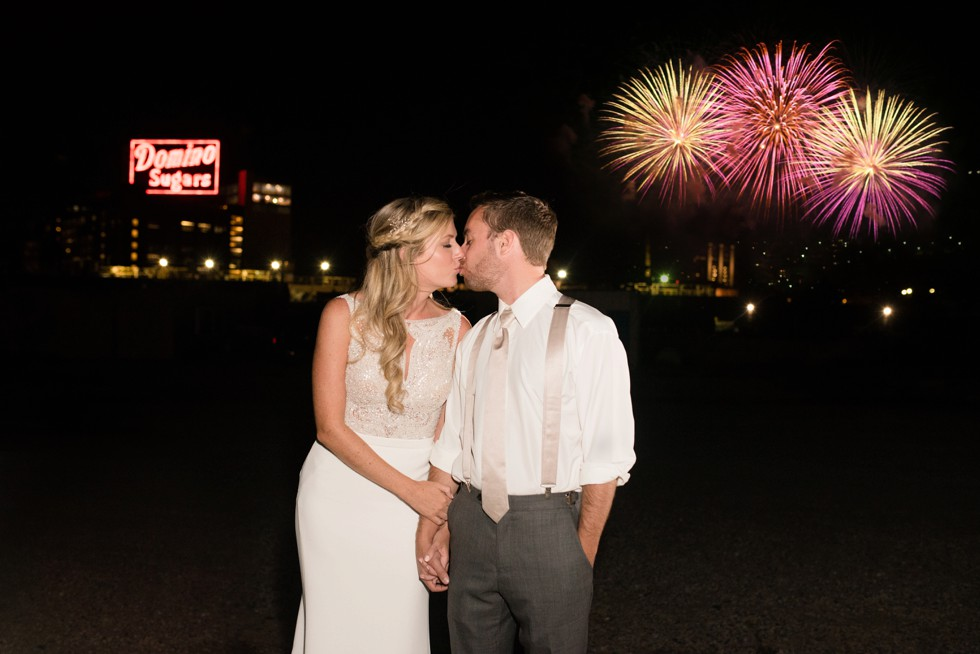 Baltimore Museum of Industry night photo of the newlyweds in front of Fireworks