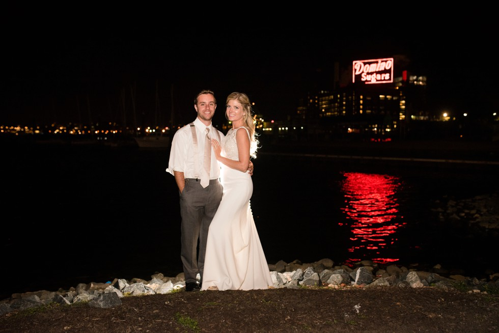 Baltimore Museum of Industry night photo of the newlyweds in front of Domino Sugar Sign