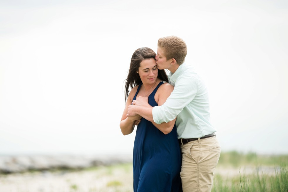 Engagement photos of two brides to be on the beach