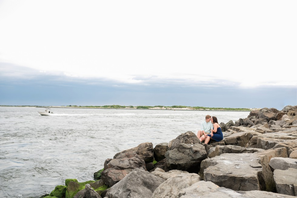 female engagement photos on the rocks at Barnegat Lighthouse