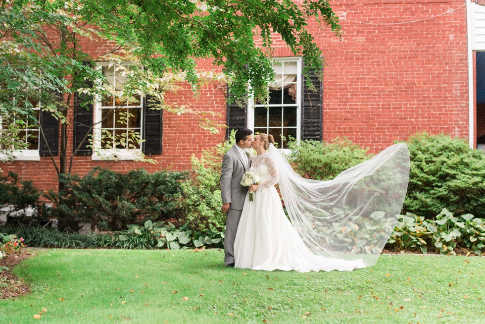 Wedding at the Elkridge Furnace inn. Epic veil bride and groom portraits with grey tux