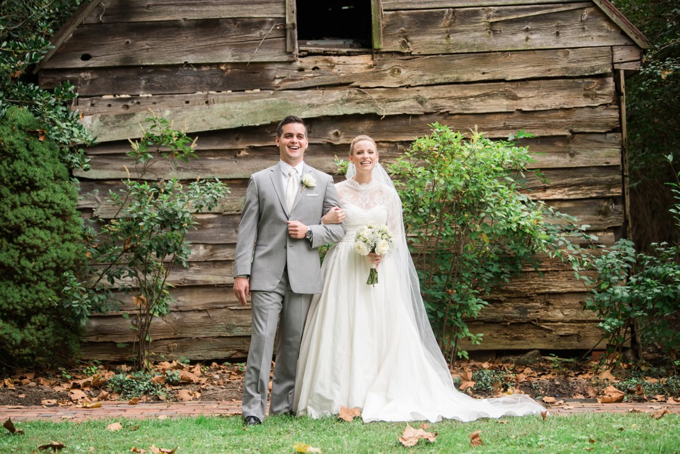 Grey mens tux and WTOO by Watters bridal dress in front of wood lodge at Elkridge Furance Inn