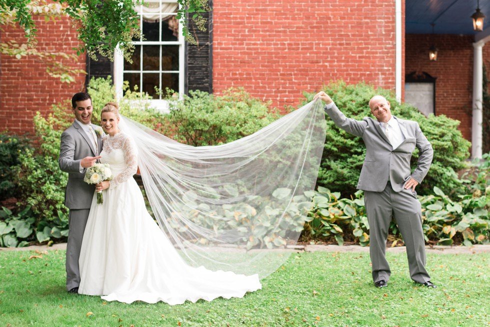 Father of the Bride helping with veil portraits