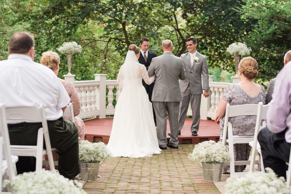 Father giving his daughter away at Elkridge Furnace Inn wedding ceremony in the garden