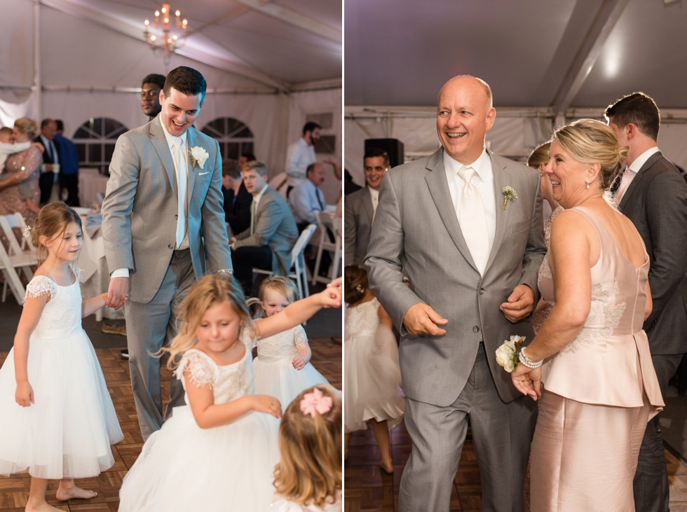 grey suits and kids dancing at a tented reception