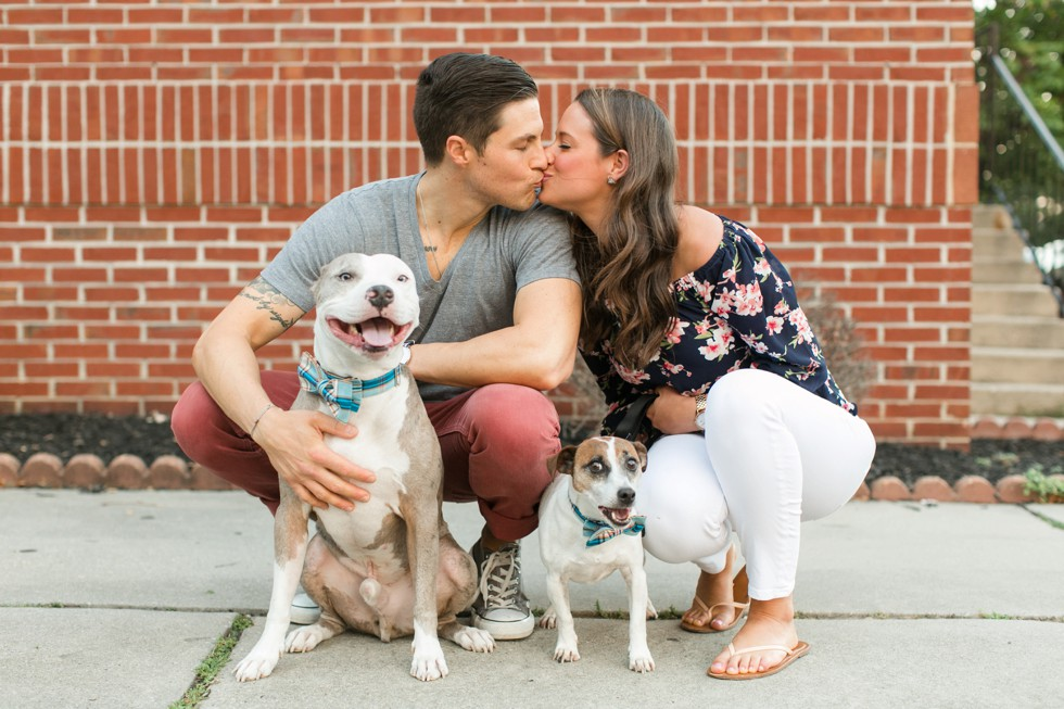 Engagement photos with two dogs in Fells Point