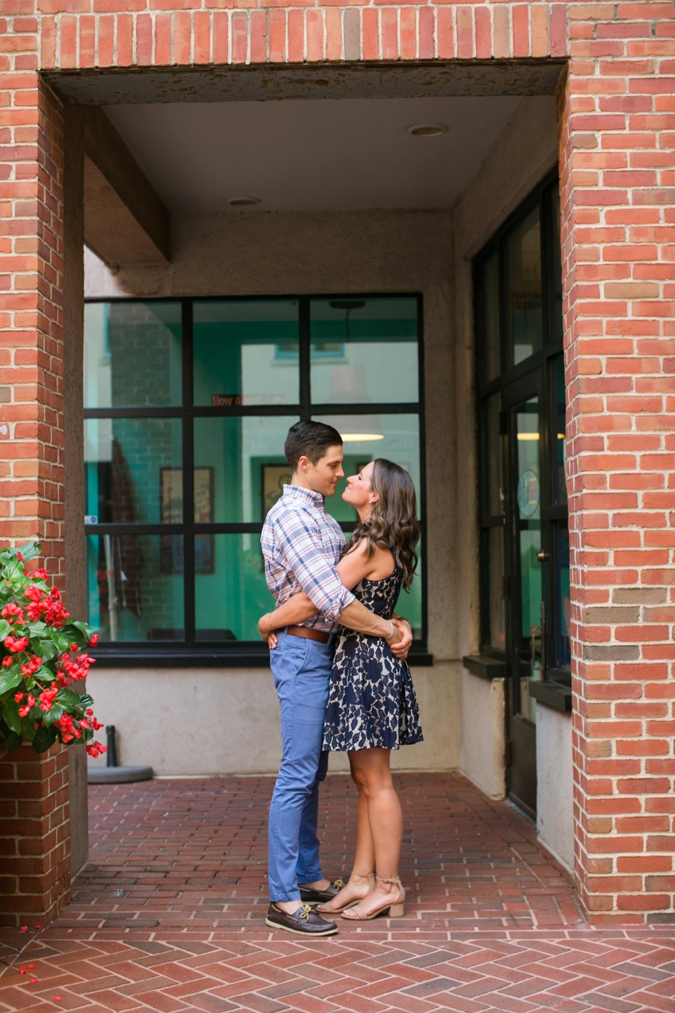 Brick building with plaid mens shirt and navy lace dress engagement outfits