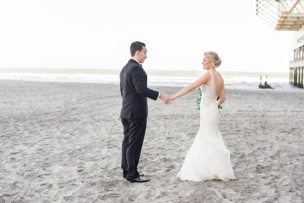Newlyweds walking down the Atlantic City beach at One Atlantic Events