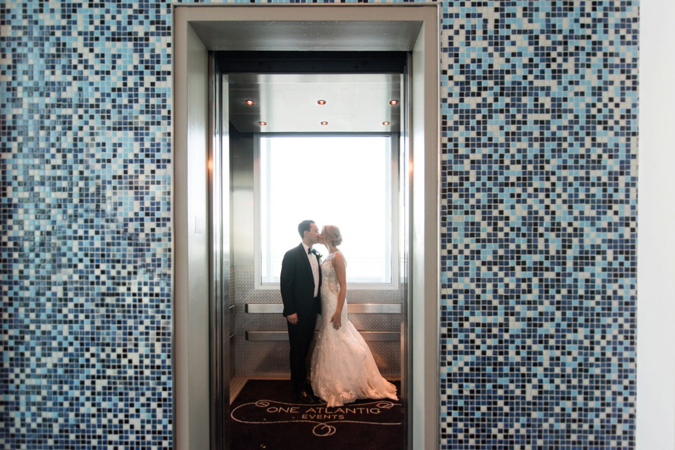 Bride and groom kissing in the elevator at One Atlantic Events