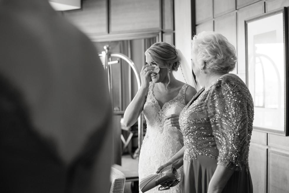 Bridesmaids putting the bride's veil on at Sheraton Hotel Atlantic City New Jersey Wedding