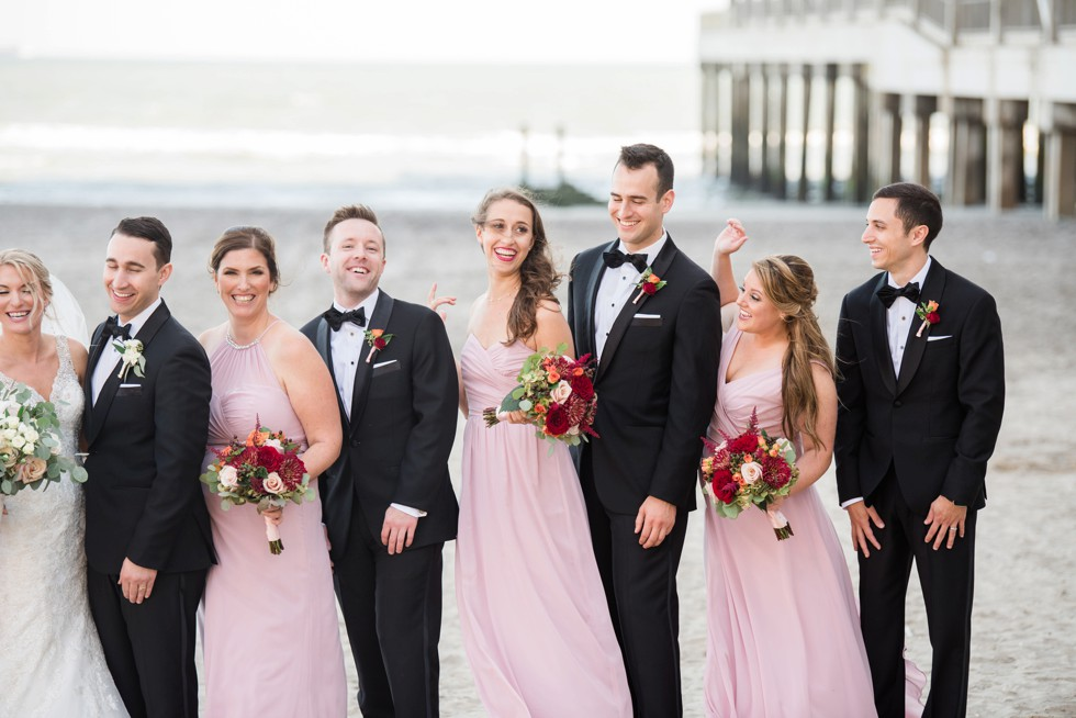 Wedding party in pink and black tux on the Atlantic City Boardwalk at One Atlantic wedding