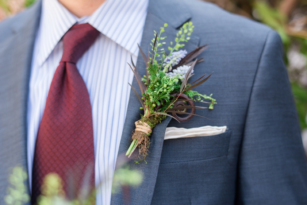 floral boutonniere on groom