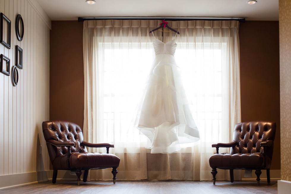 Matthew Christopher bridal dress hanging in the window at The Inn at the Chesapeake Bay Beach Club