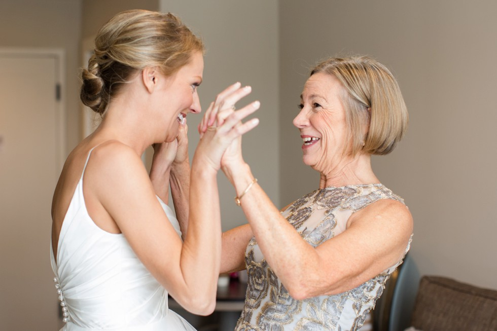 Bride and her mom getting in her wedding dress at The Inn at the Chesapeake Bay Beach Club