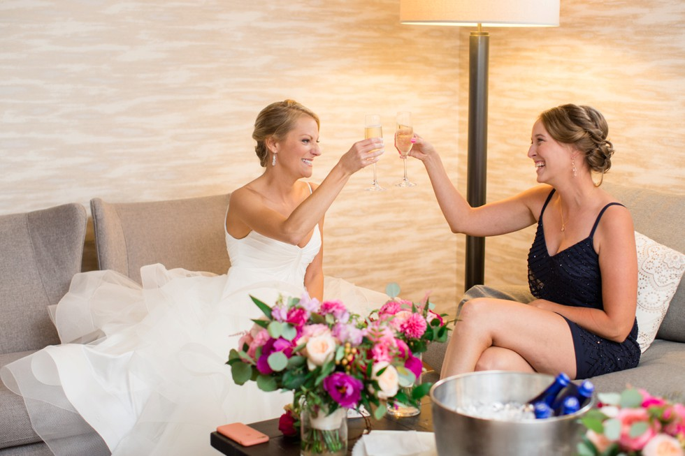 Bride and bridesmaid cheersing in the Beach house bridal suite at the Chesapeake Bay Beach Club