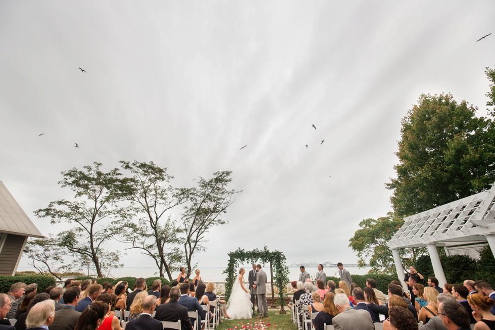 outdoor Fall wedding ceremony overlooking the Chesapeake Bay Bridge