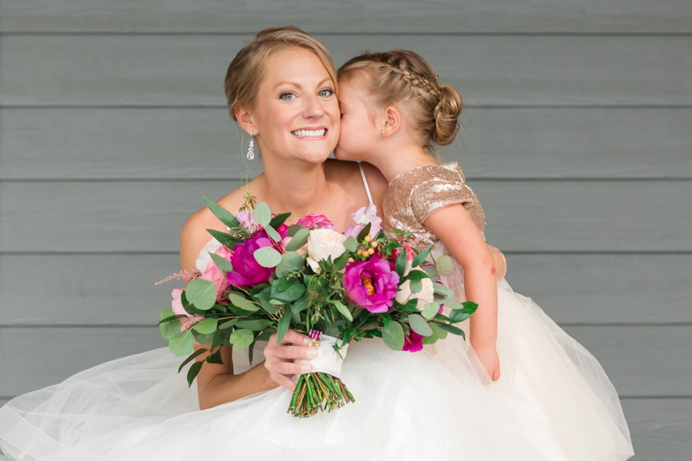 Bride and flower girl with bright pink flowers from Floral and Bloom Designs