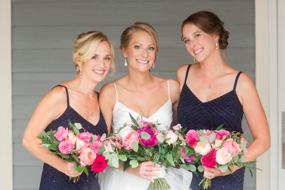 Bride and bridesmaids with bright pink flowers from Floral and Bloom Designs