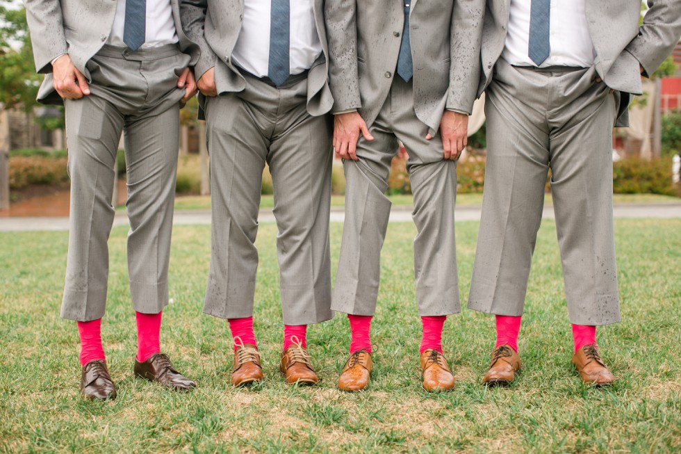 Groom and groomsmen matching bright pink red socks