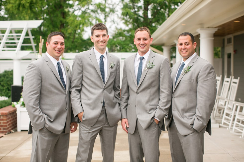 Groom and groomsmen formal portrait at the Beach Club after the ceremony