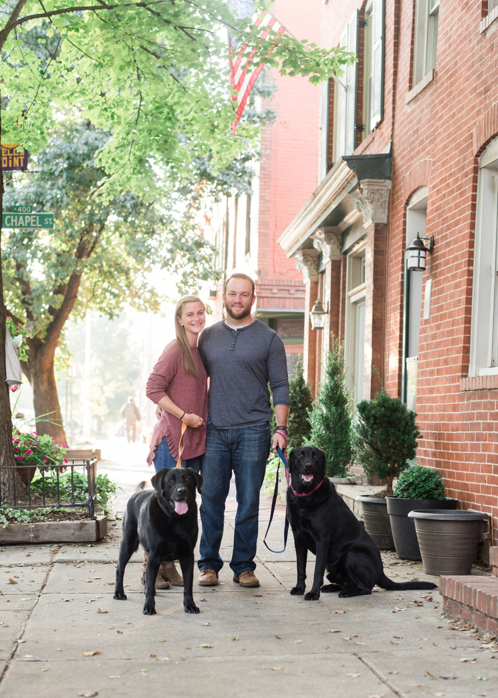 black labs in engagement photos at home