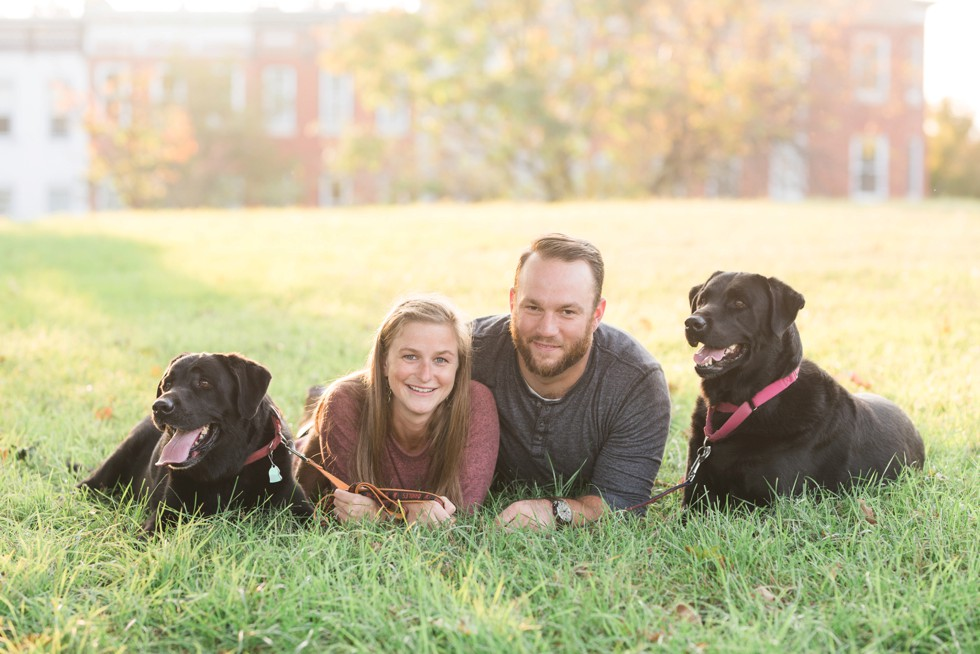 Black labs in engagement photos at Patterson Park near Fells Point