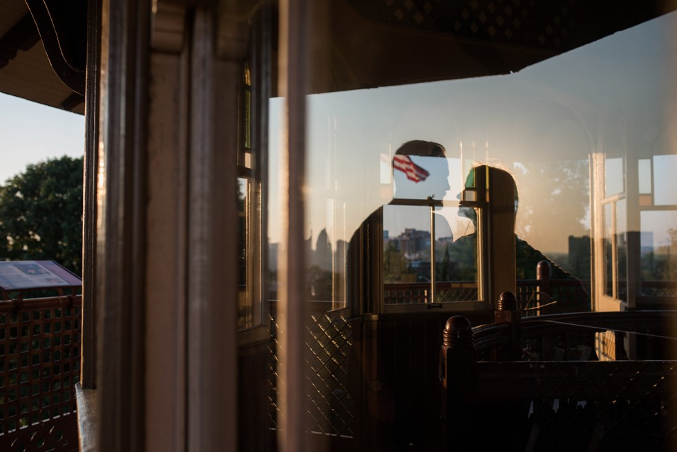 Engagement photo reflection At the top of Patterson Park Pagoda overlooking Baltimore