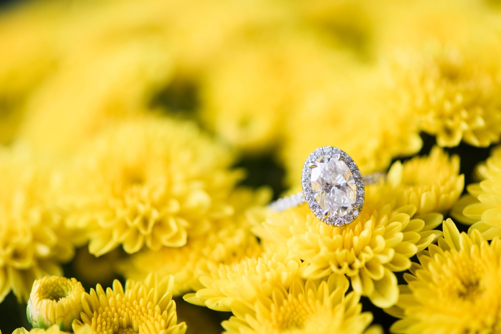 oval engagement ring on yellow mums