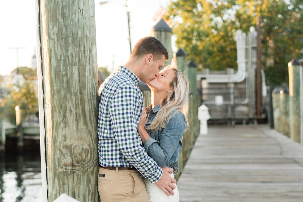 Annapolis city dock engaged couple in jean jacket