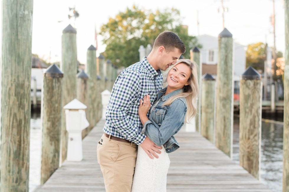 engaged couple on a pier in Annapolis