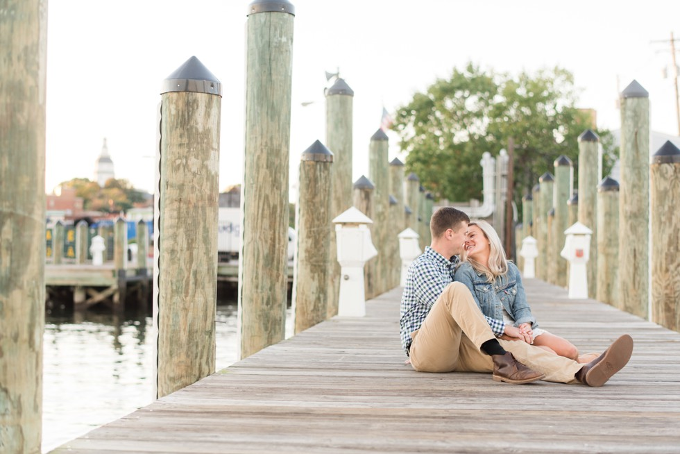 couple kissing on the docks in Annapolis
