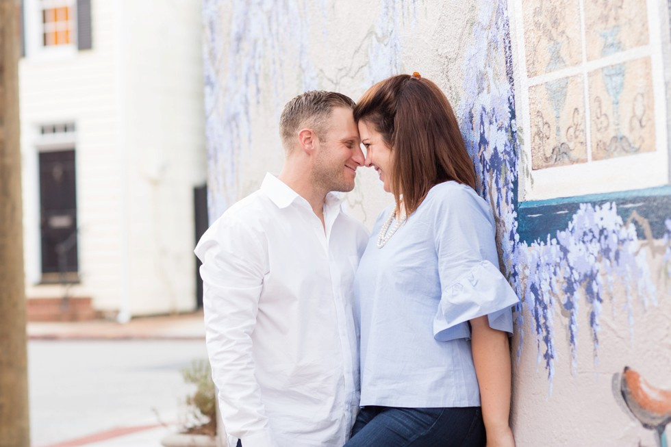 Engaged couple on Annapolis Mural
