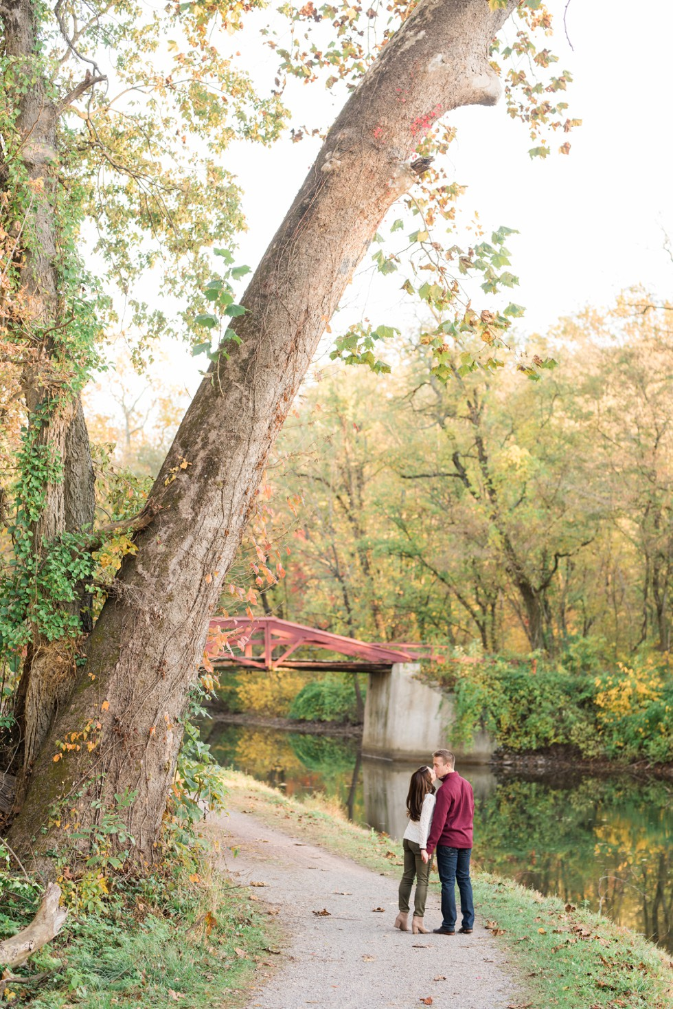 Fall engagement photos in Washington Crossing Historic Park red bridge
