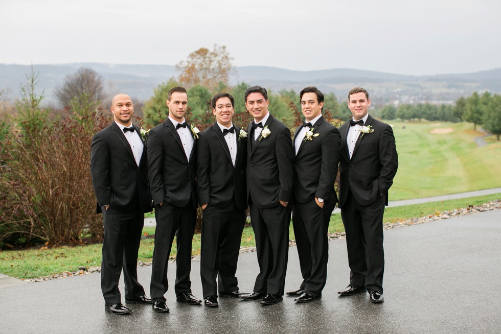 groomsmen in black tuxes on a mountain wedding