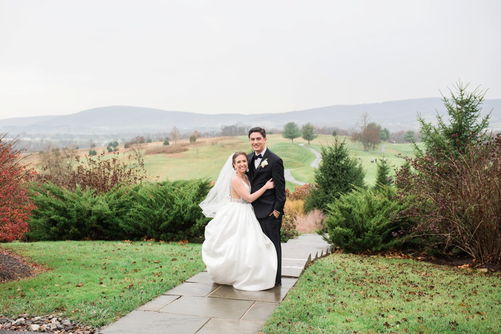bride and groom on mountain in Frederick