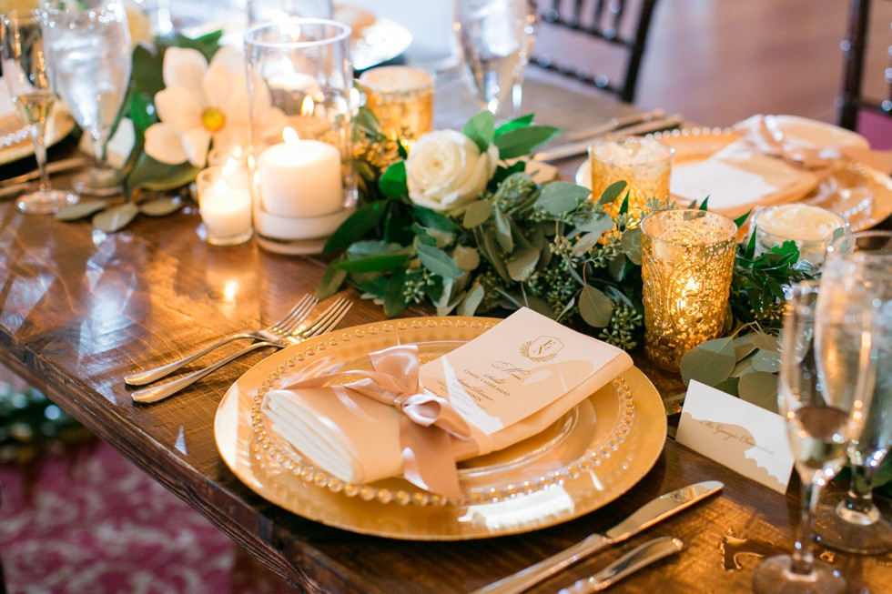 gold pears magnolia and gold chargers Wicked Willow Event Florals