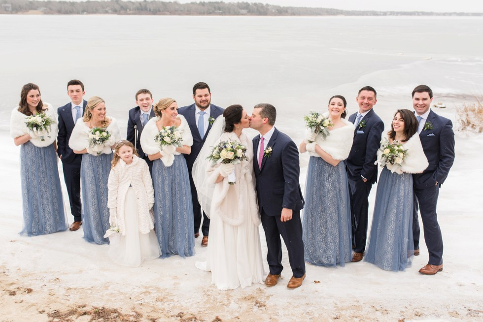 Snowy winter wedding party Waquoit Bay Cape Cod