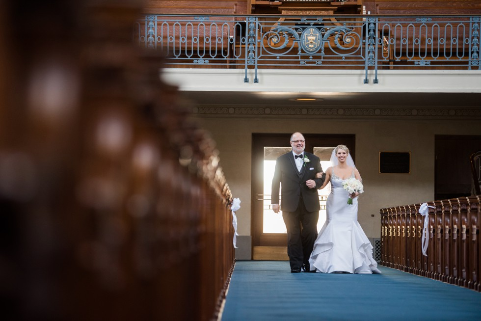 Bride and father walking the aisle US Naval Academy Chapel wedding