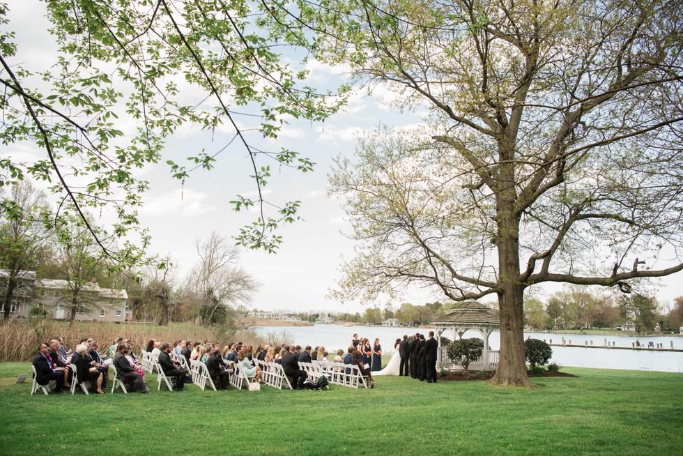Outdoor spring wedding ceremony Kent Manor Inn