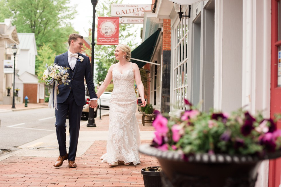 bride and groom strolling on the charming street of Easton