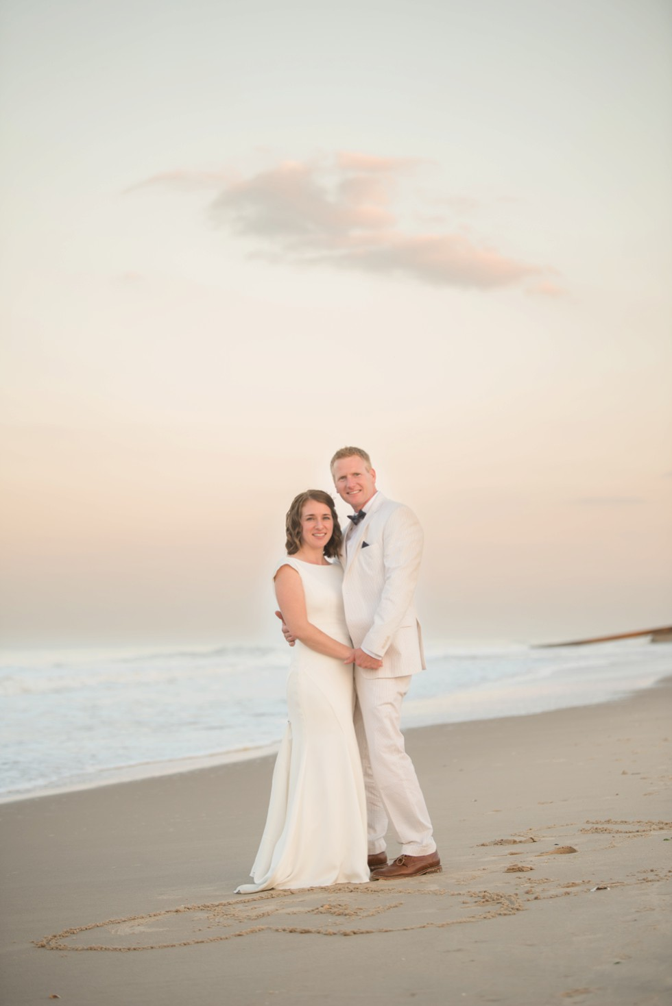 Beach sunset bride and groom