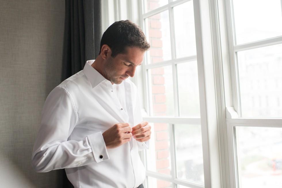 groom getting ready at Le Meridien
