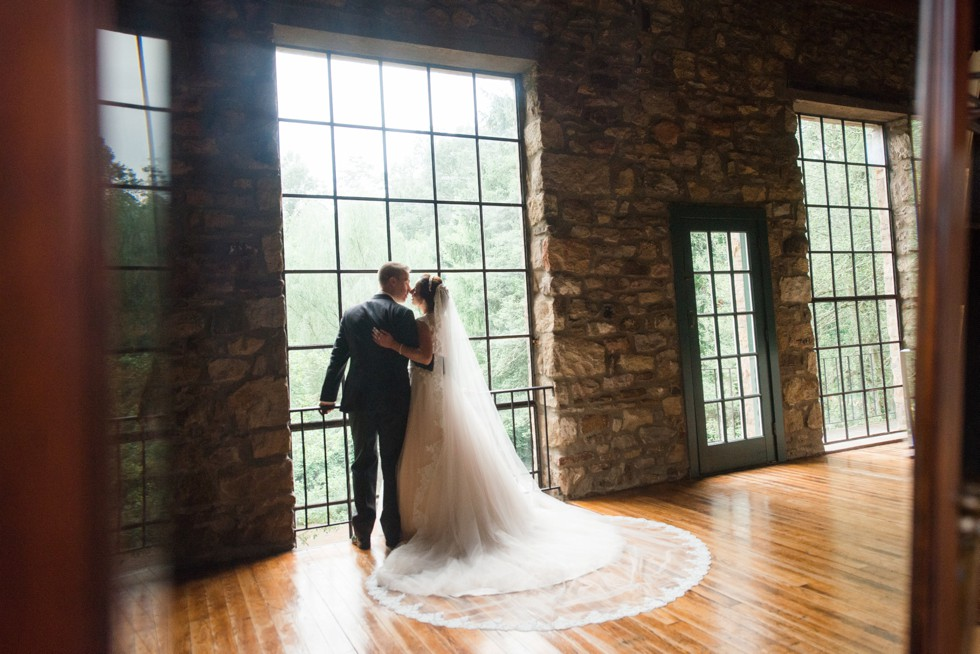 Holly Hedge estate bride and groom in front of Windows